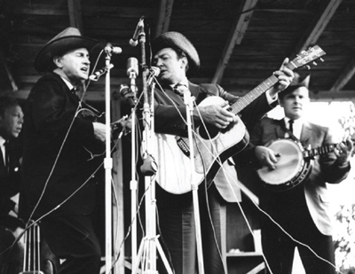 Fincastle Virginia, 1965 L:R - George Shuffler, Bill Monroe, Carter Stanley and Ralph Stanley. (Photo by Ron Petronko.)